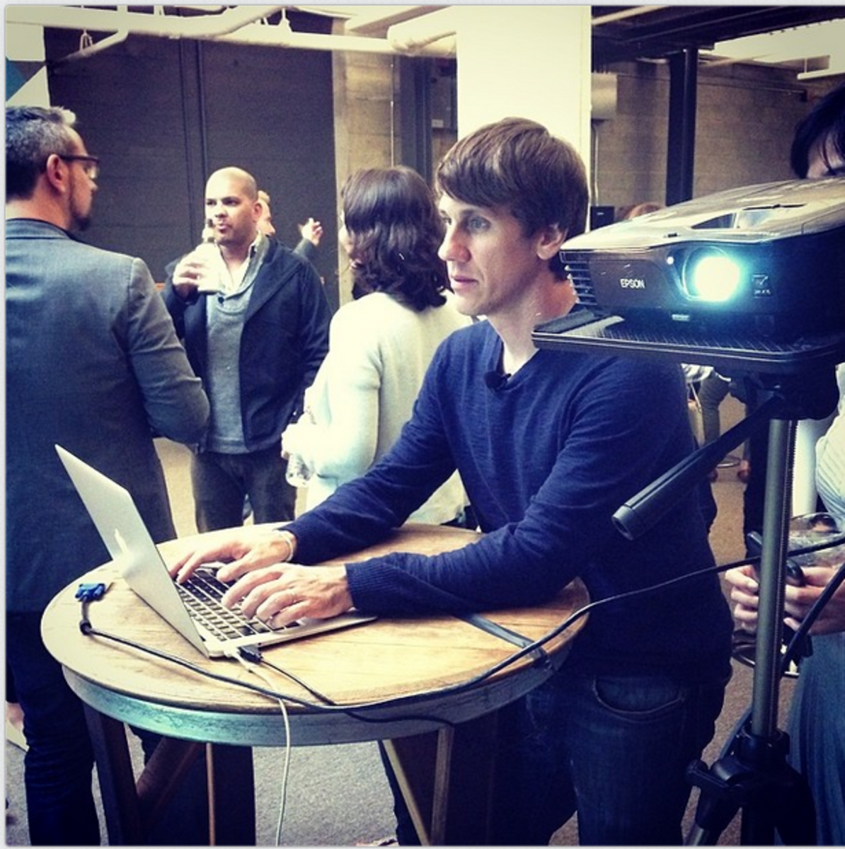 Dennis Crowley playing with the FourSquare API demo, photo via Owen Thomas
